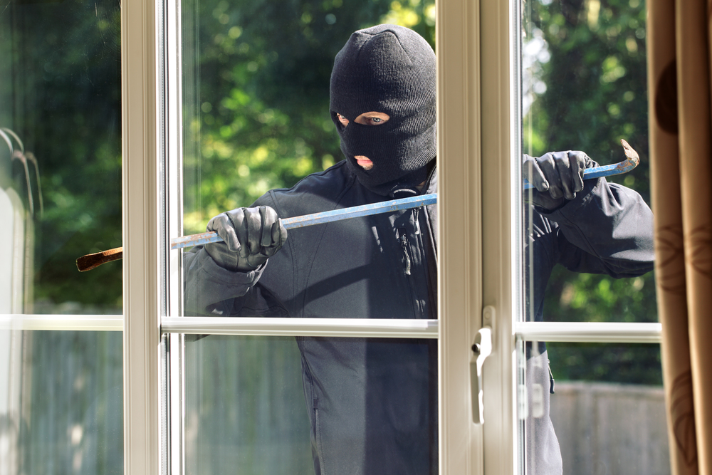 burglar-window-breaking-in