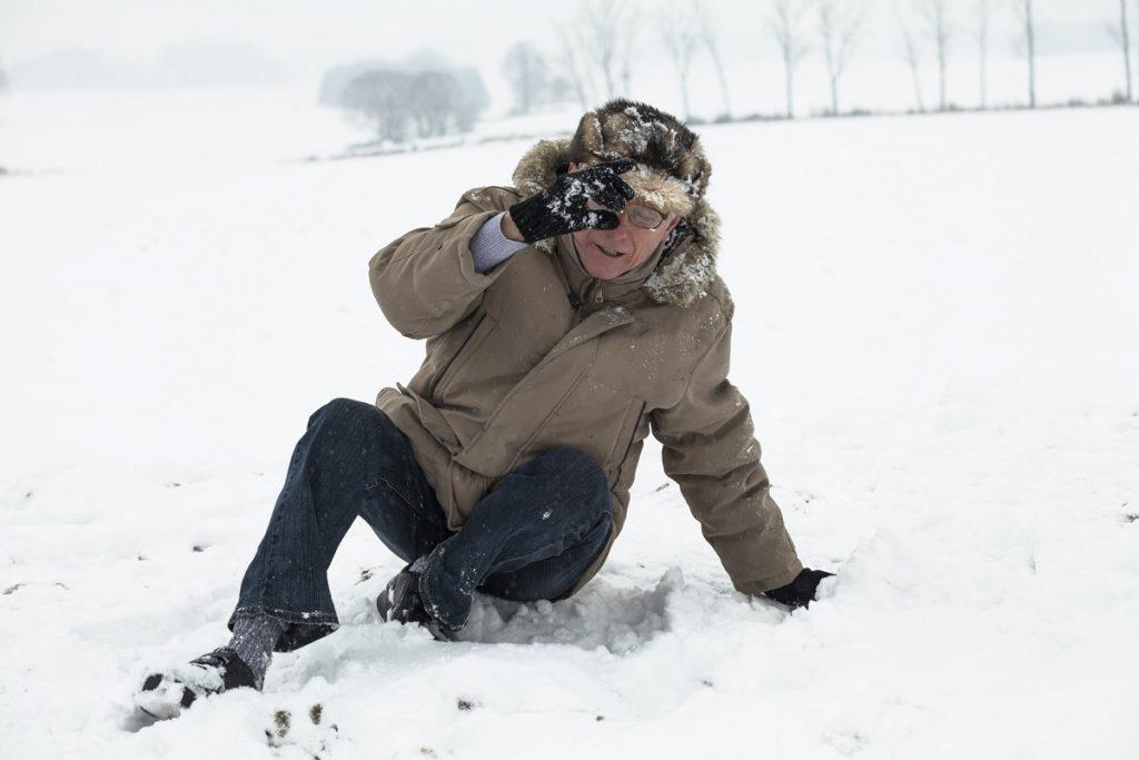 Elderly gentleman slips on snow and ice